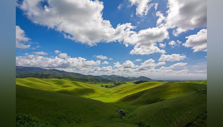 May contain: nature, outdoors, countryside, hill, grassland, and field