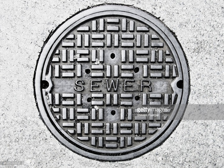 May contain: sewer, drain, manhole, hole, architecture, tower, clock tower, and building