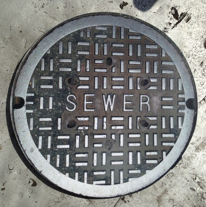 May contain: sewer, hole, manhole, drain, and rug