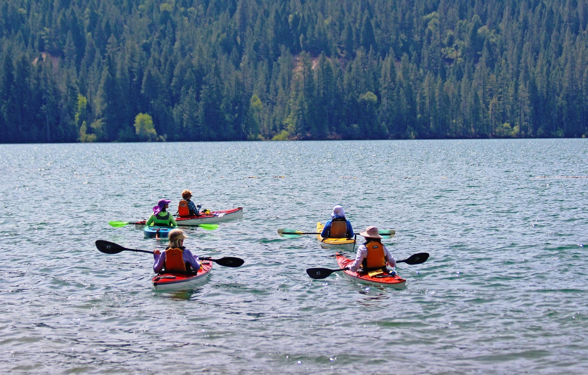 May contain: person, human, boat, vehicle, transportation, kayak, rowboat, and canoe