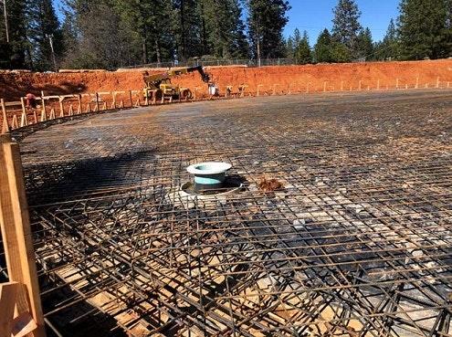 construction, rebar, tank site, trees, sky, equipment