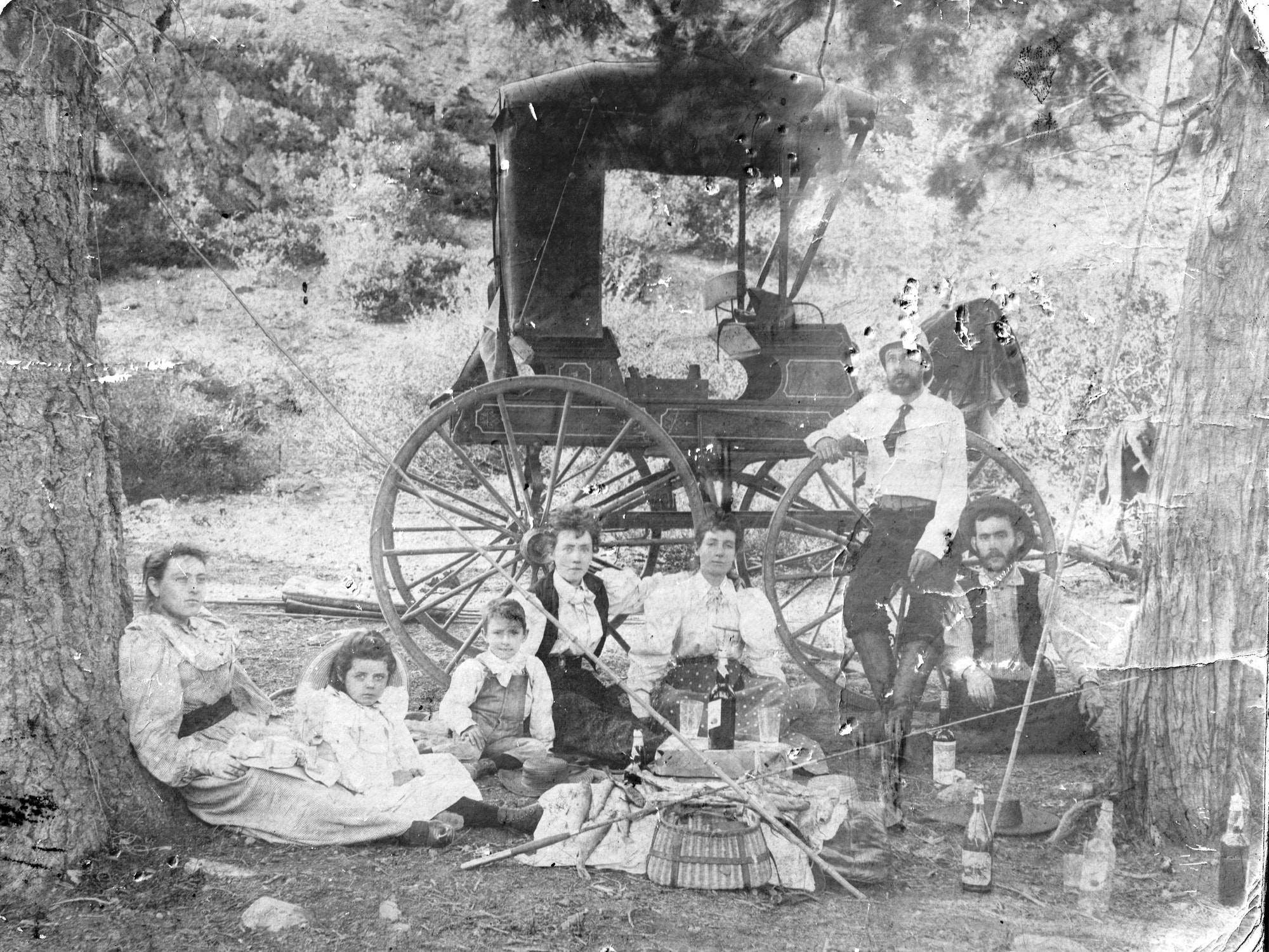 A family enjoys an outing at Bowman Lake in 1897.
