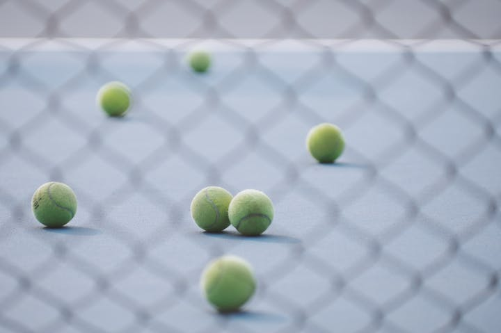 May contain: tennis ball, sport, ball, tennis, and sports