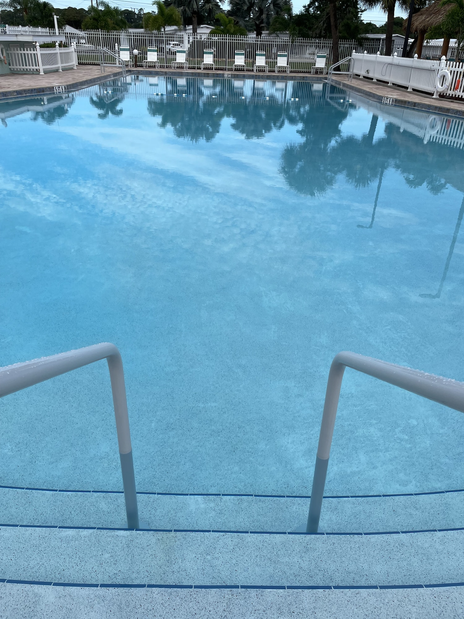 May contain: pool, water, swimming pool, handrail, and banister