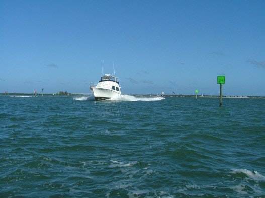 boat on intracoastal waters by green navigation marker