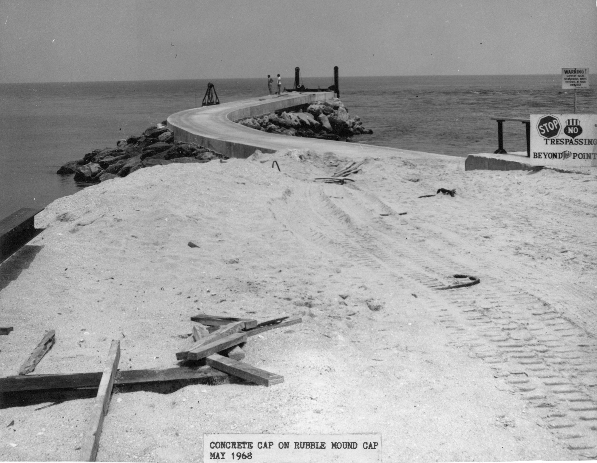 view of north jetty construction site in 1968 as it begins to jut out into the ocean