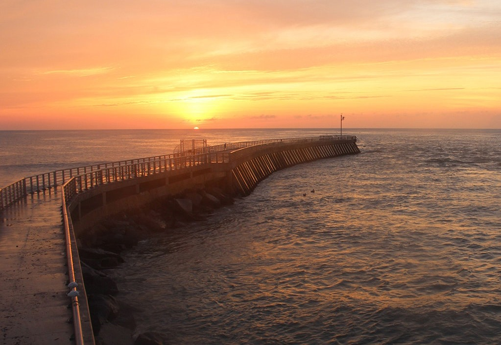 sunrise over the jetty and ocean