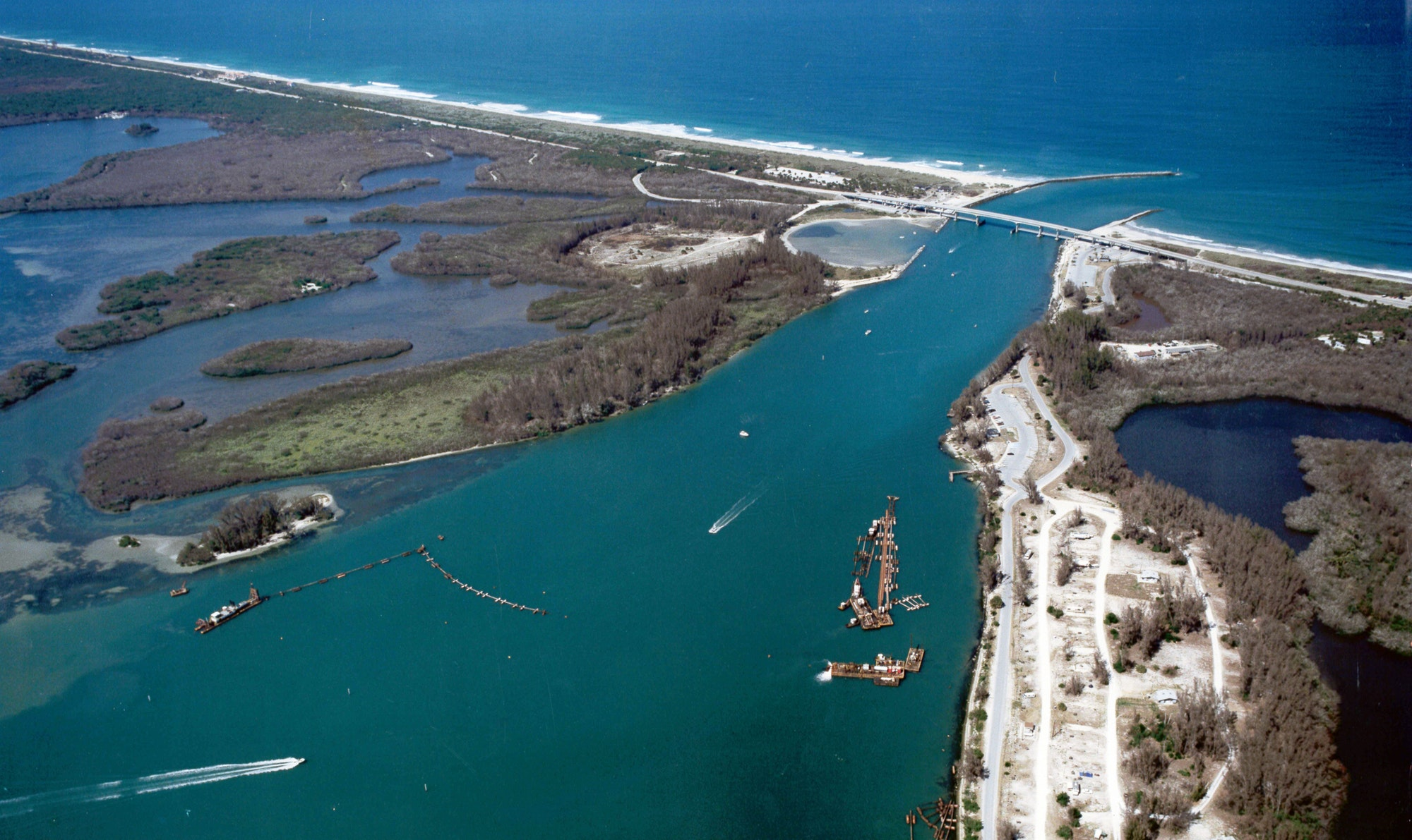 aerial view of inlet looking East with dredging equipment in channel