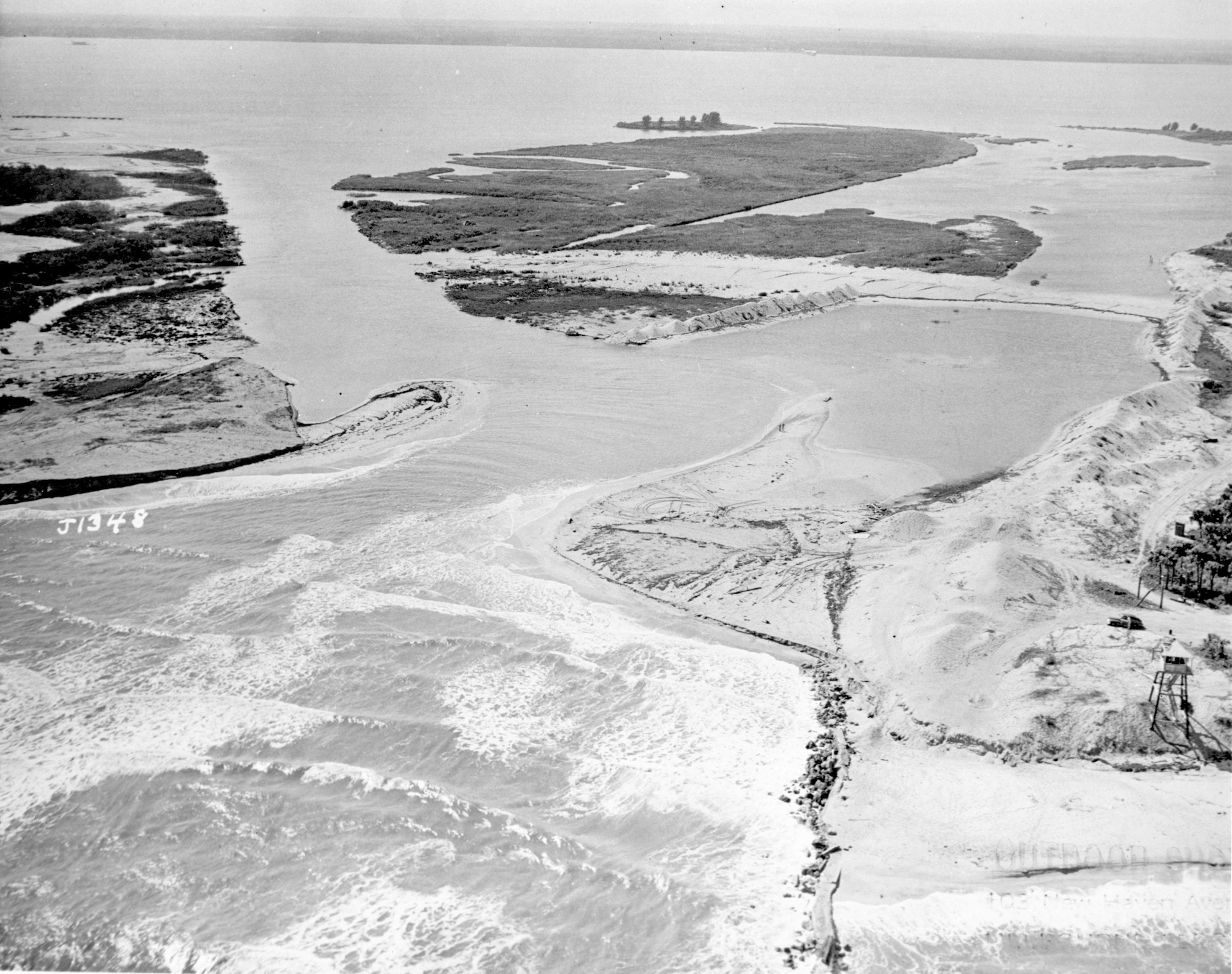 Aerial view of the open inlet from 1948 showing the connection of the Indian River and Atlantic Ocean