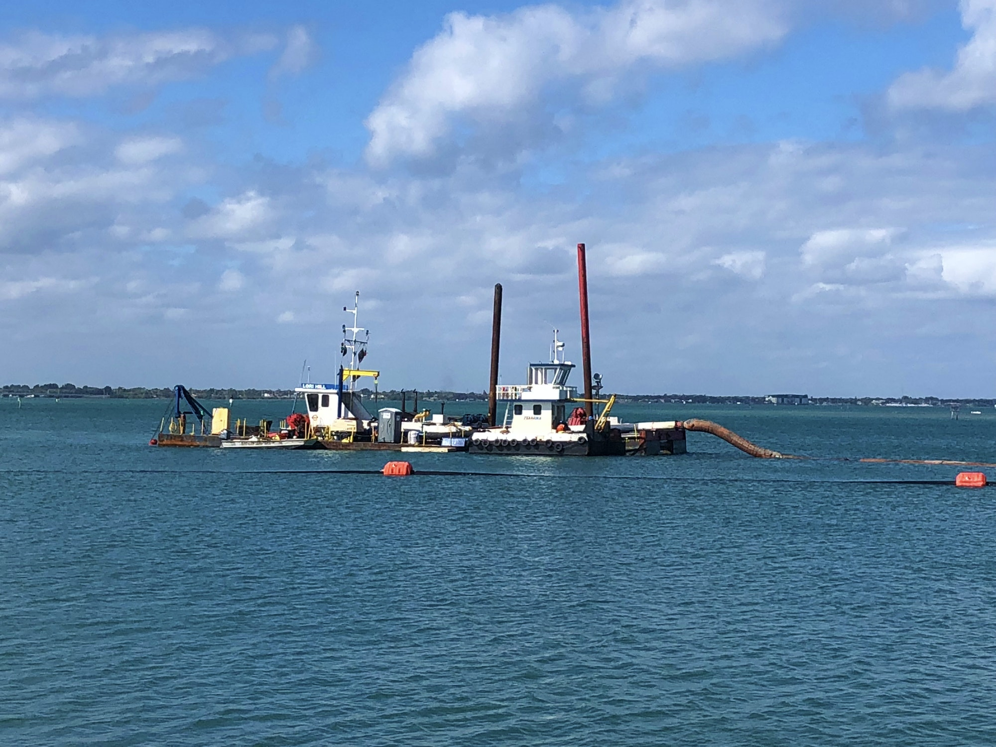 Dredge boat floating on water