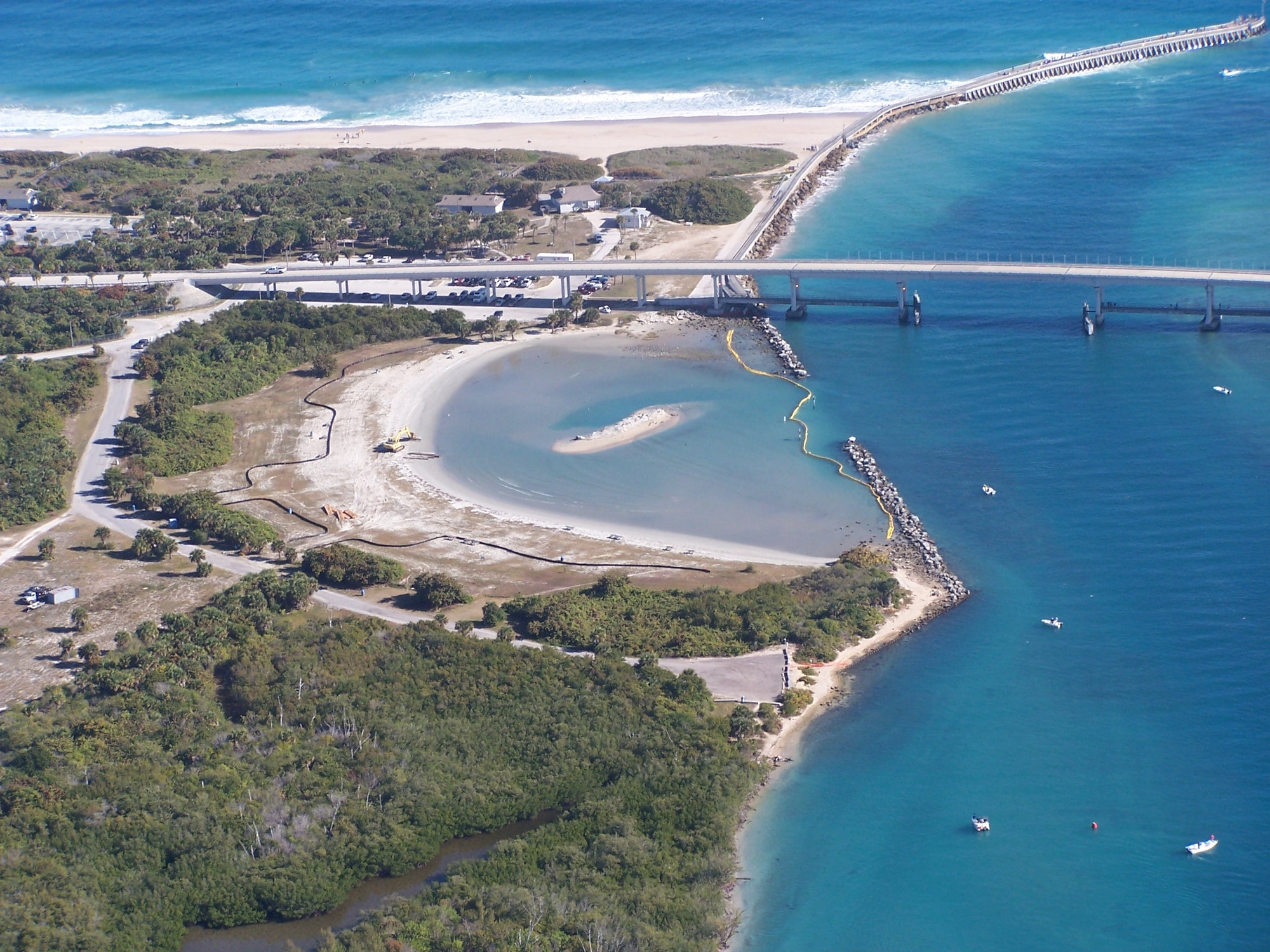 aerial view of tide pool at Sebastian Inlet looking East showing a portion of the channel on the right
