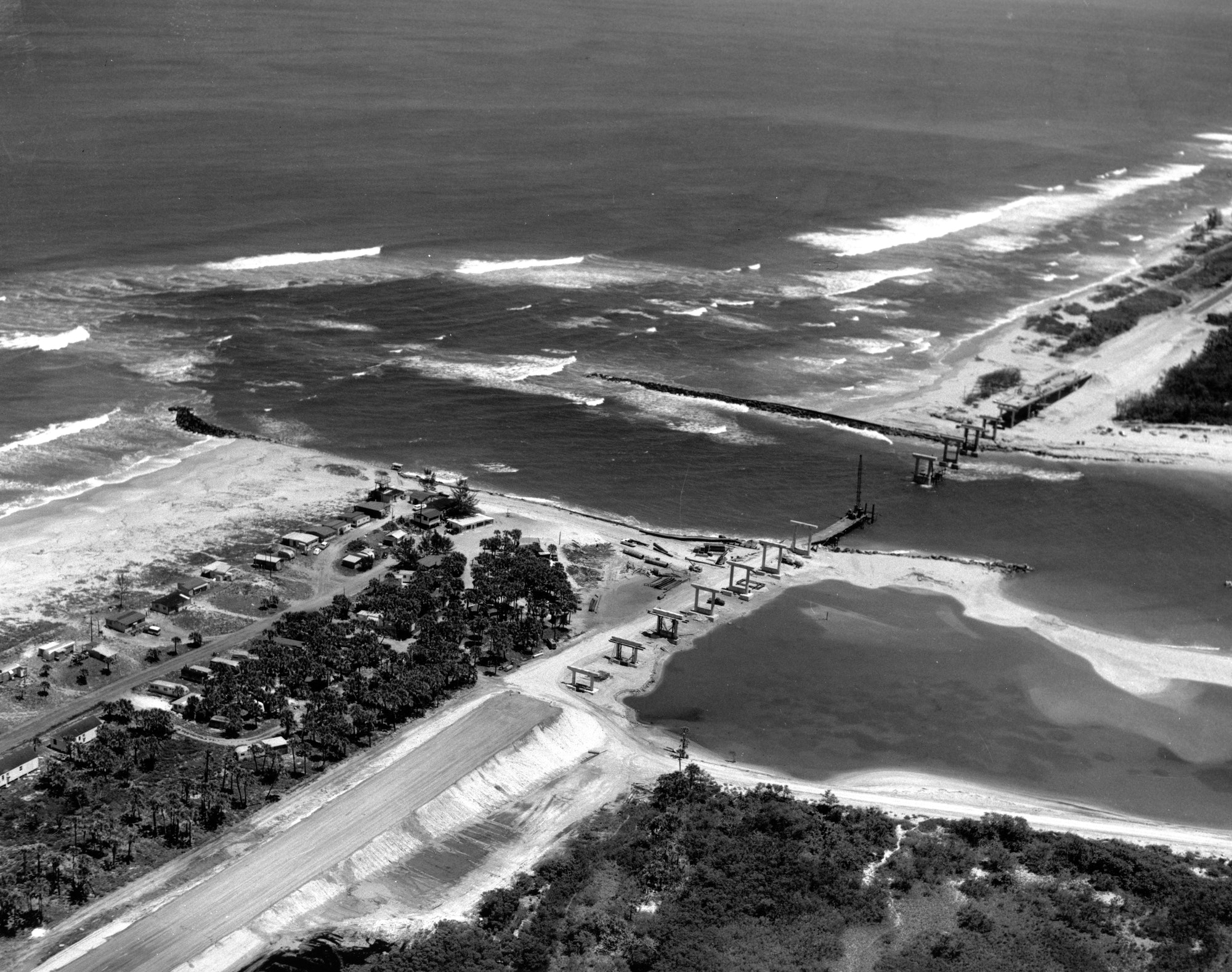 aerial view of bridge construction over Sebastian Inlet looking South