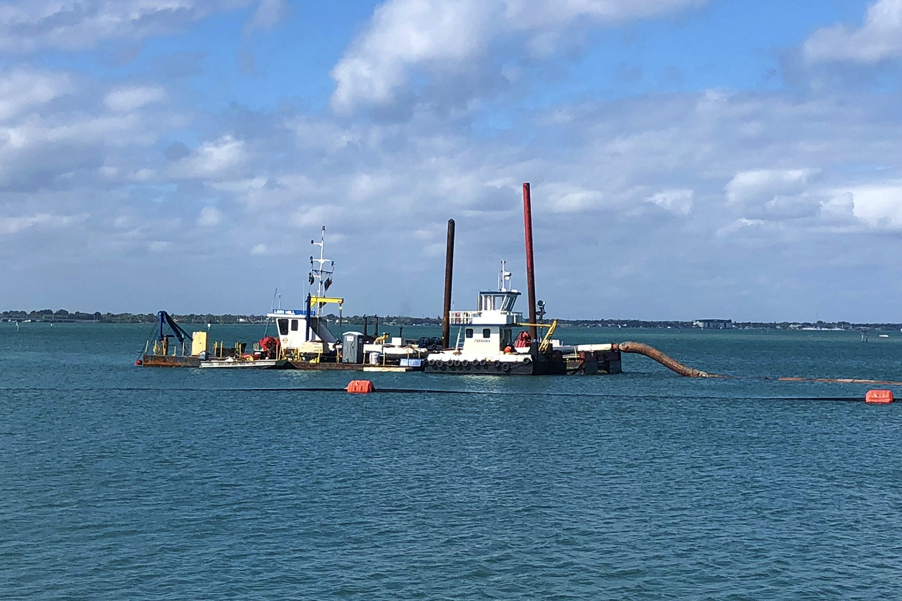 "photo of dredge ""Lori Hill"" on the Sebastian Inlet flood shoal"