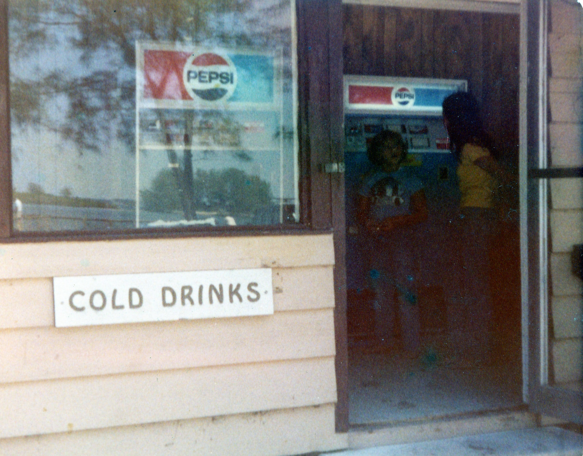 cold drinks signs showing soda vending machines in building at state park
