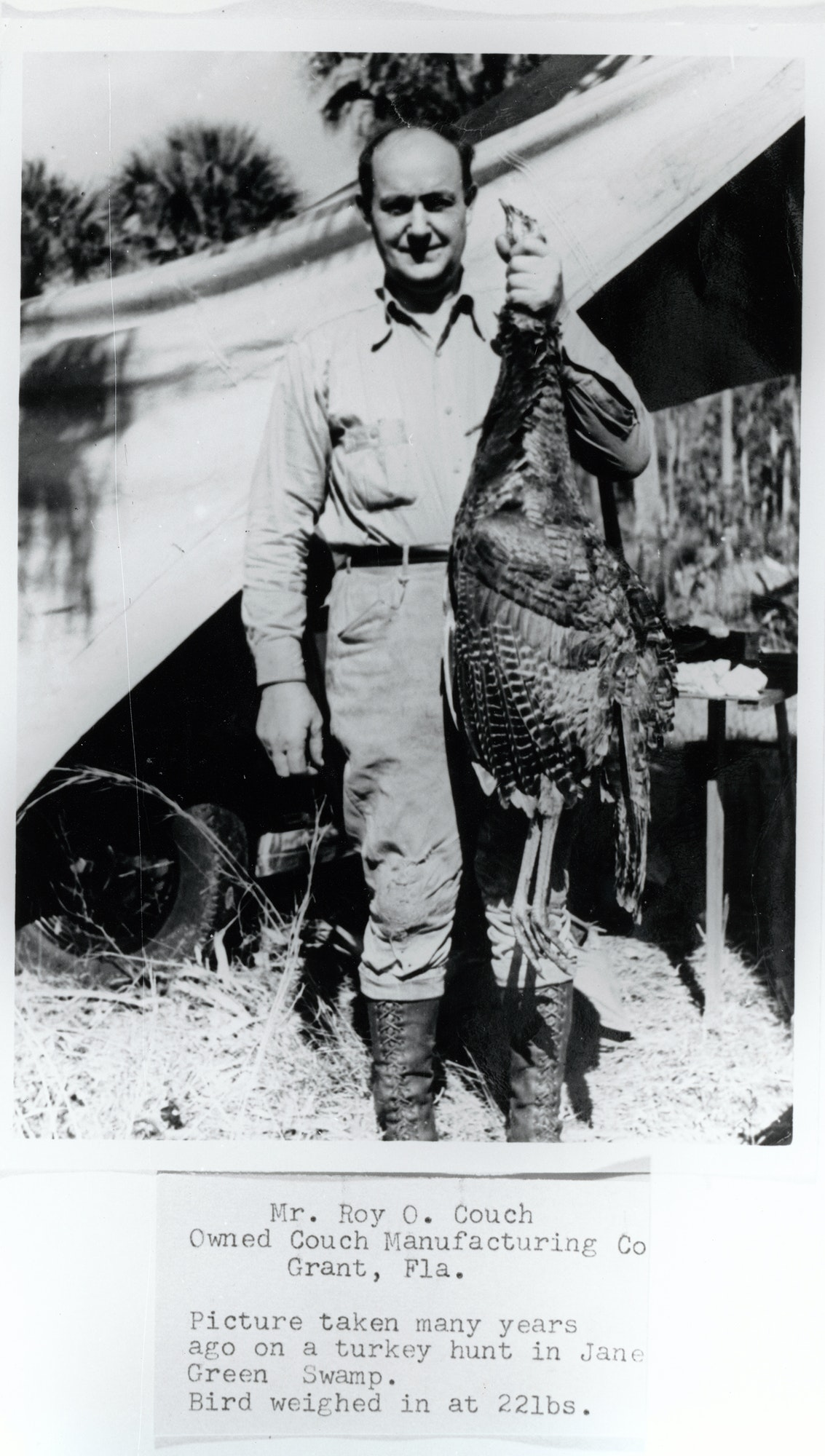 historical photo of Roy O. Couch holding a turkey he caught hunting