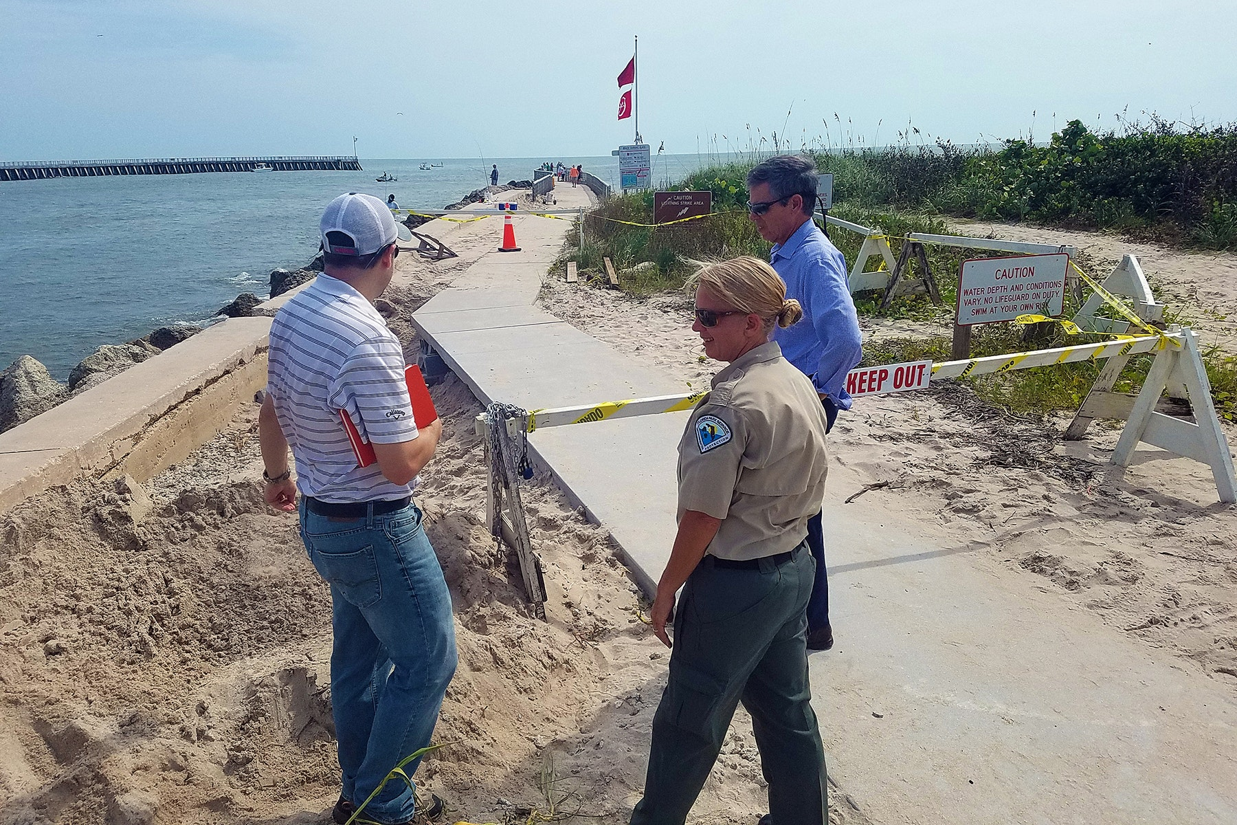 James Gray, Park Manager Jennifer Roberts and James Kershaw inspecting the base on the South Jetty