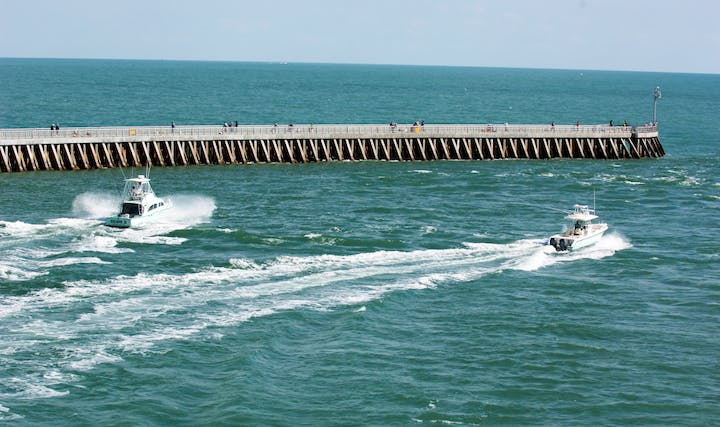 Two boats exiting Sebastian Inlet by the North Jetty