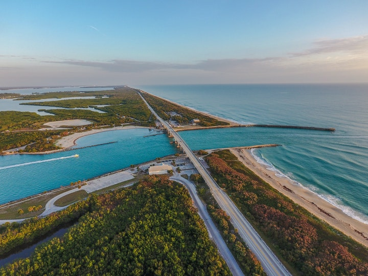 aerial of sebastian inlet waterway looking North at sunrise