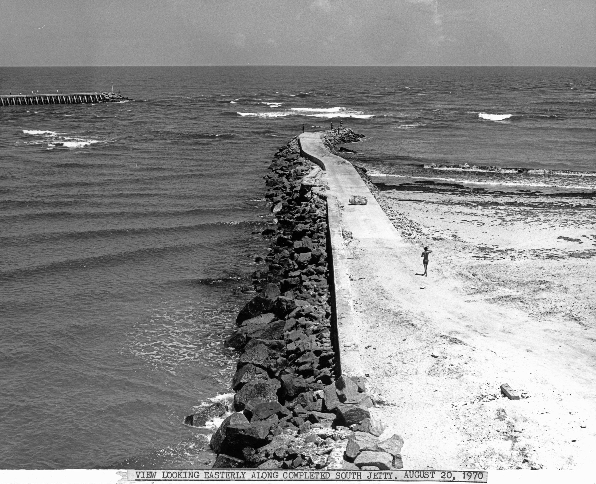view of the completed South Jetty extending into the Atlantic Ocean