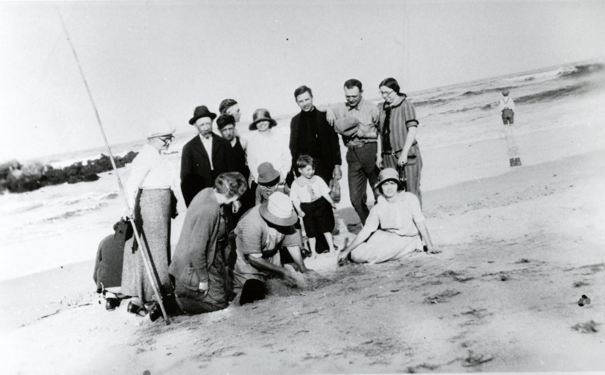 historical photo of a group of people at the inlet on the beach from 1920s or 1930s