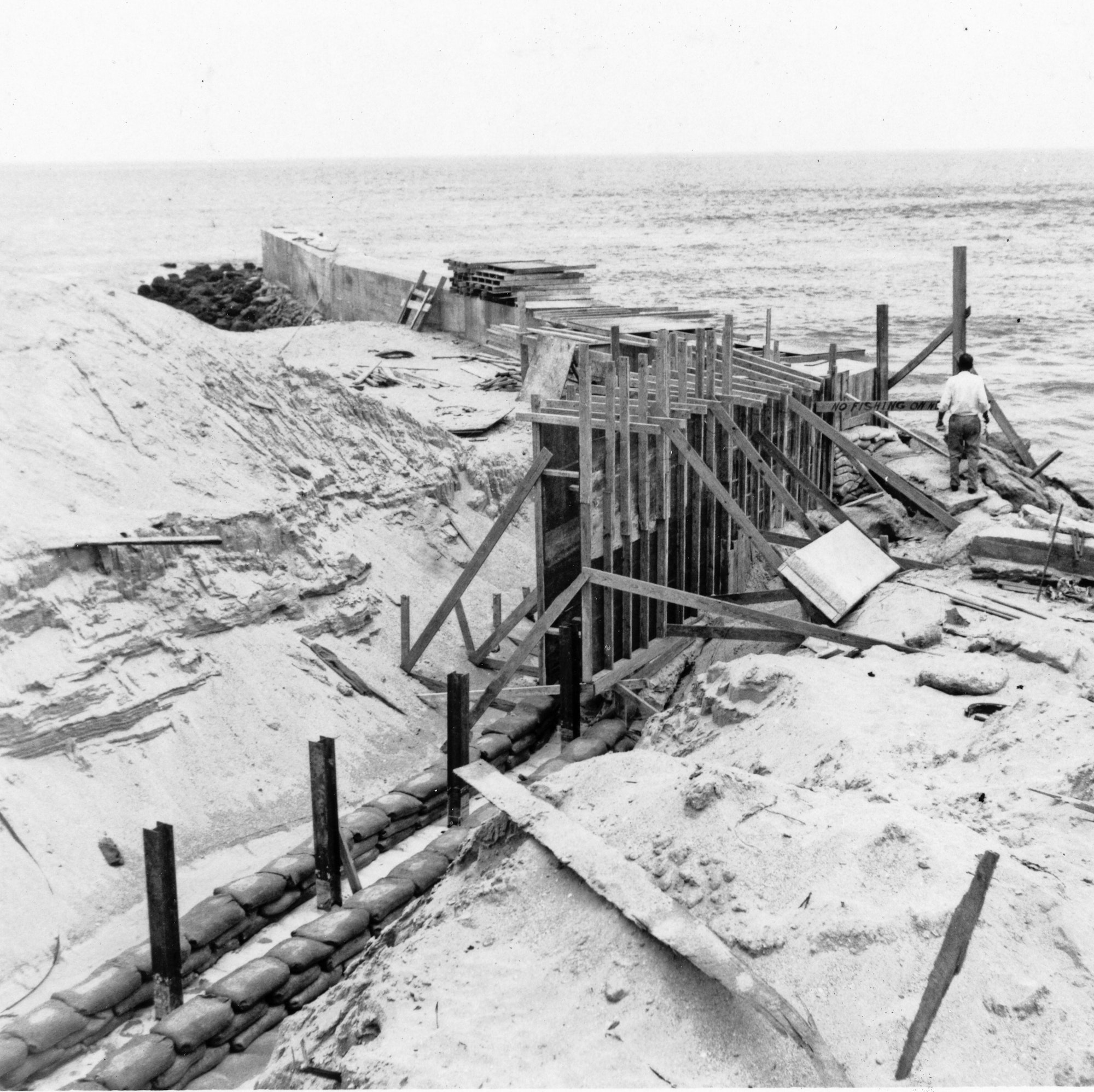 wooden support structures used to begin north jetty construction