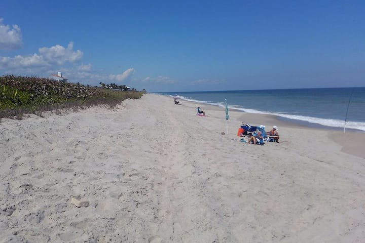 view of Ambersand beach looking North with several beach goers
