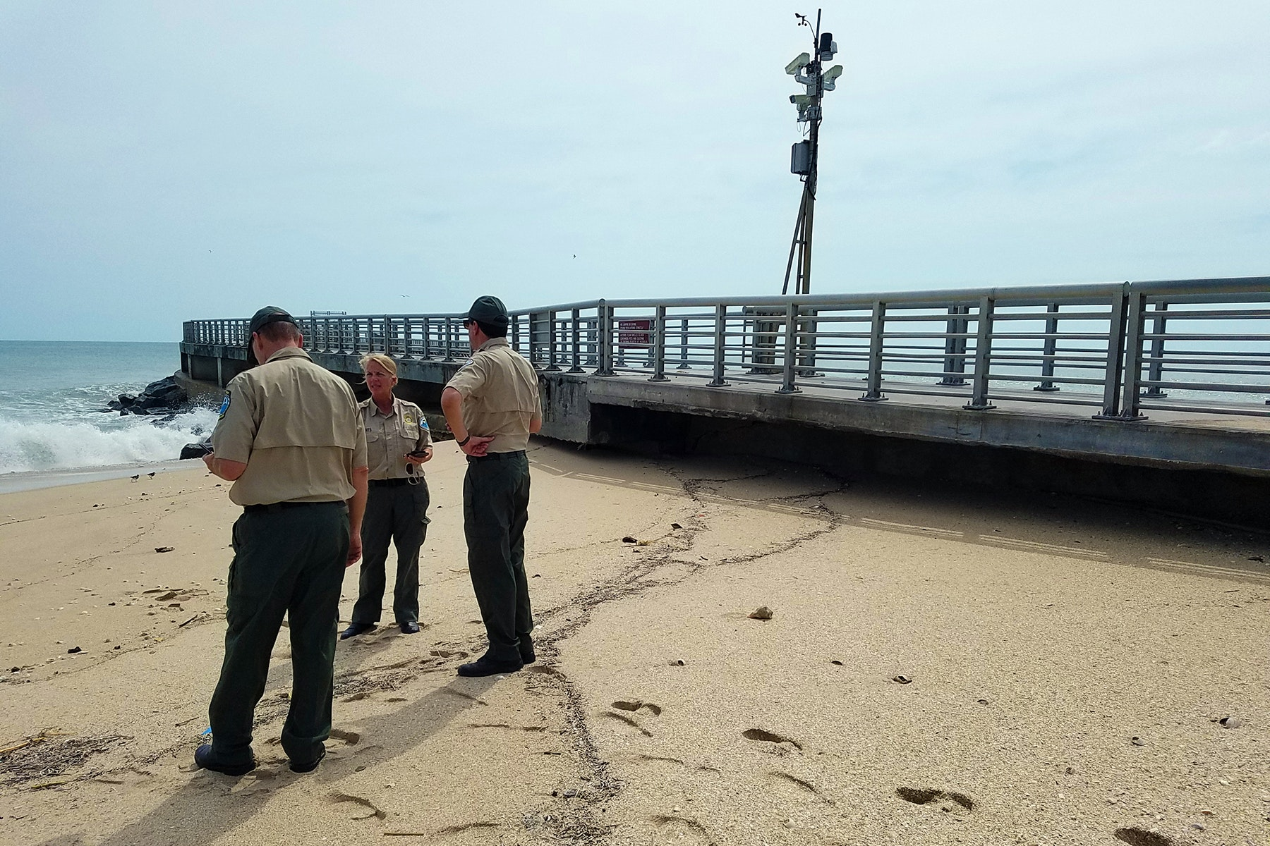 State Park officials inspecting the base of the North Jetty