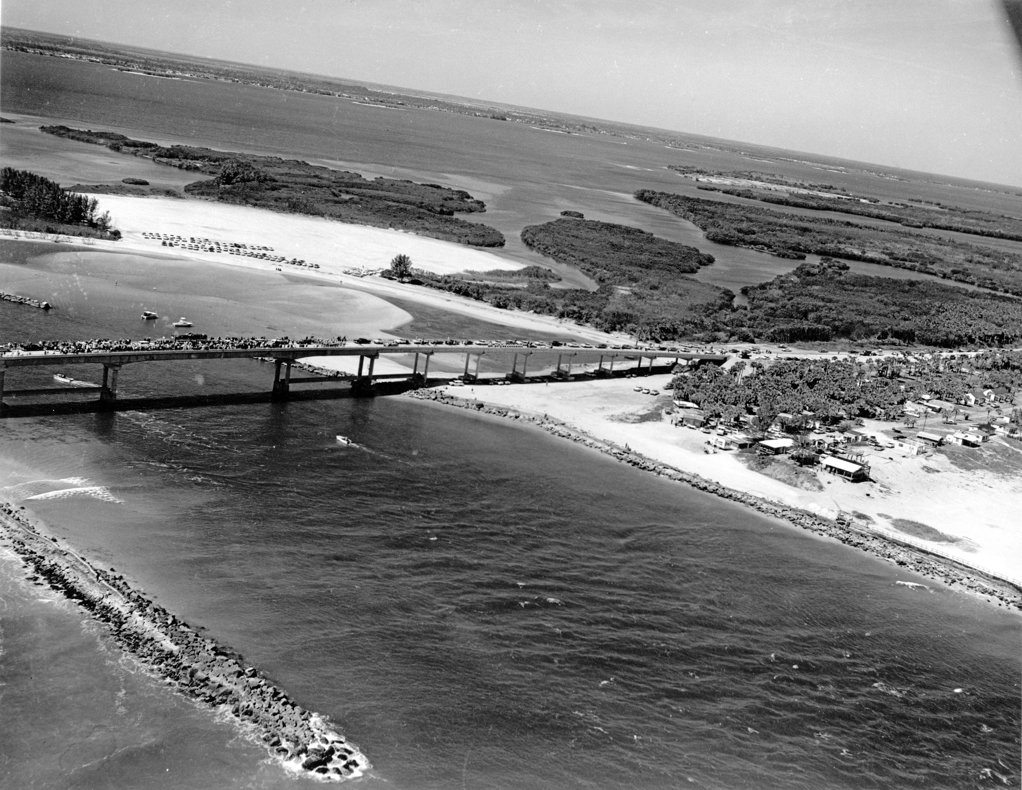 aerial view of completed bridge over Sebastian Inlet, looking Northwest, on opening day with people lining the bridge