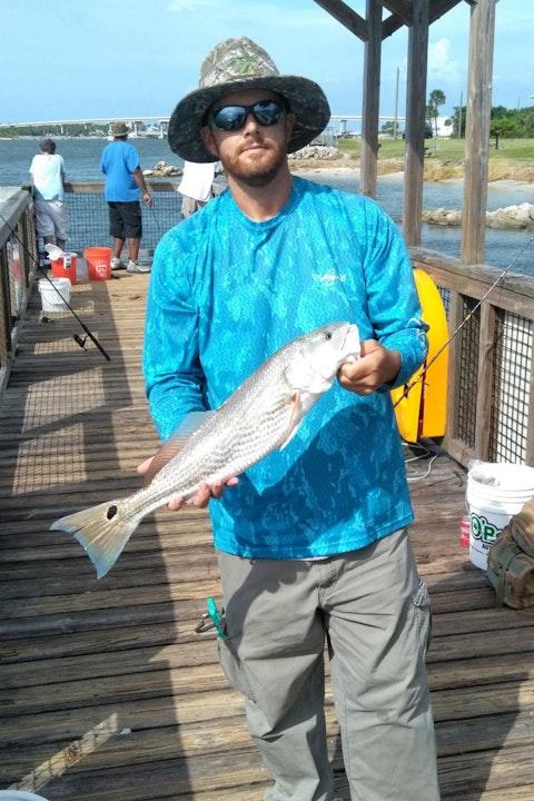 Fisherman holding a redfish