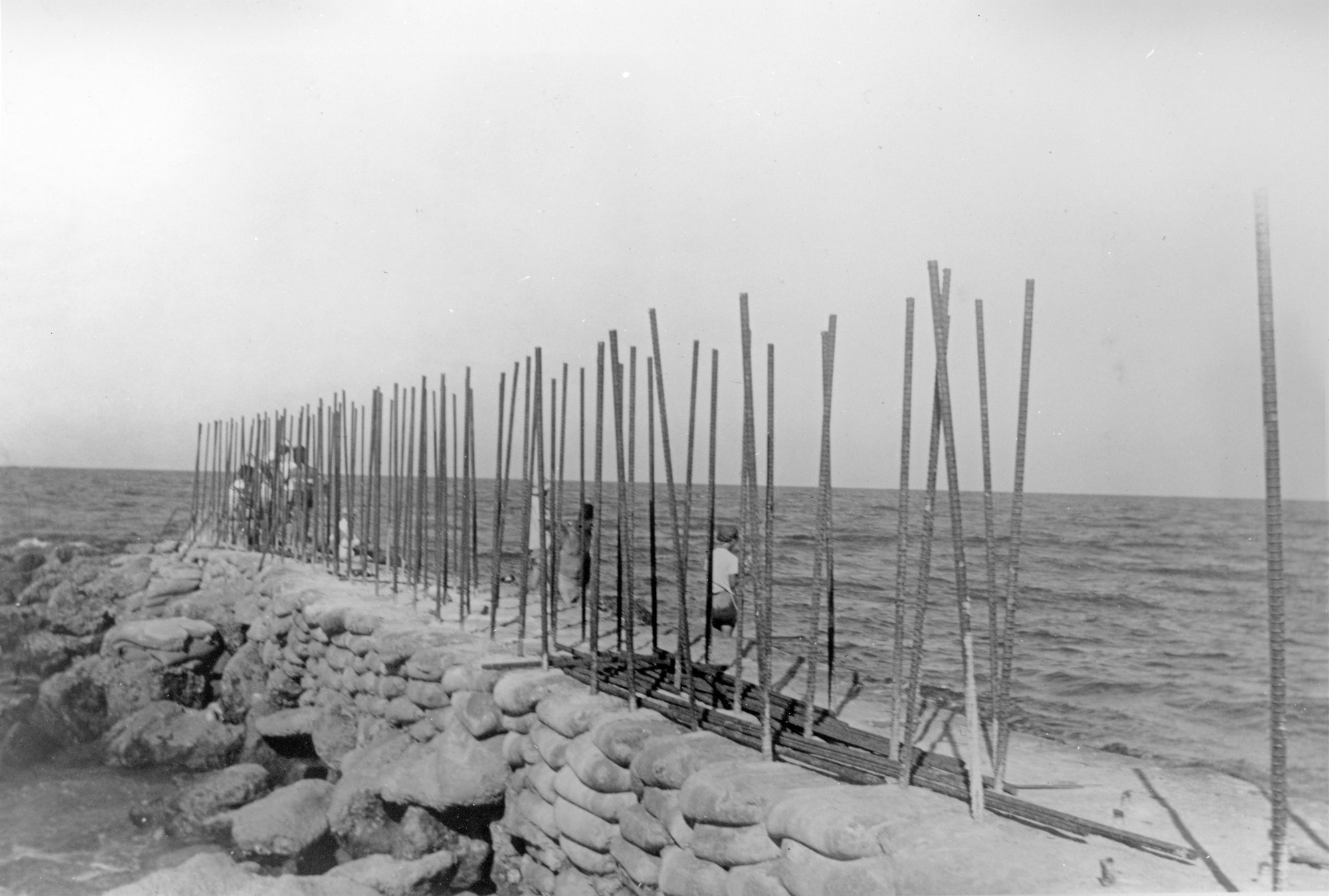stacked concrete bags with rebar during jetty construction