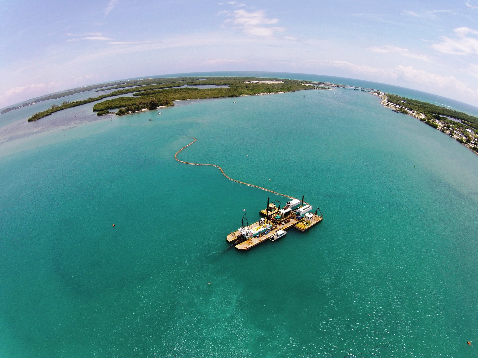 aerial view of dredge floating over inlet channel
