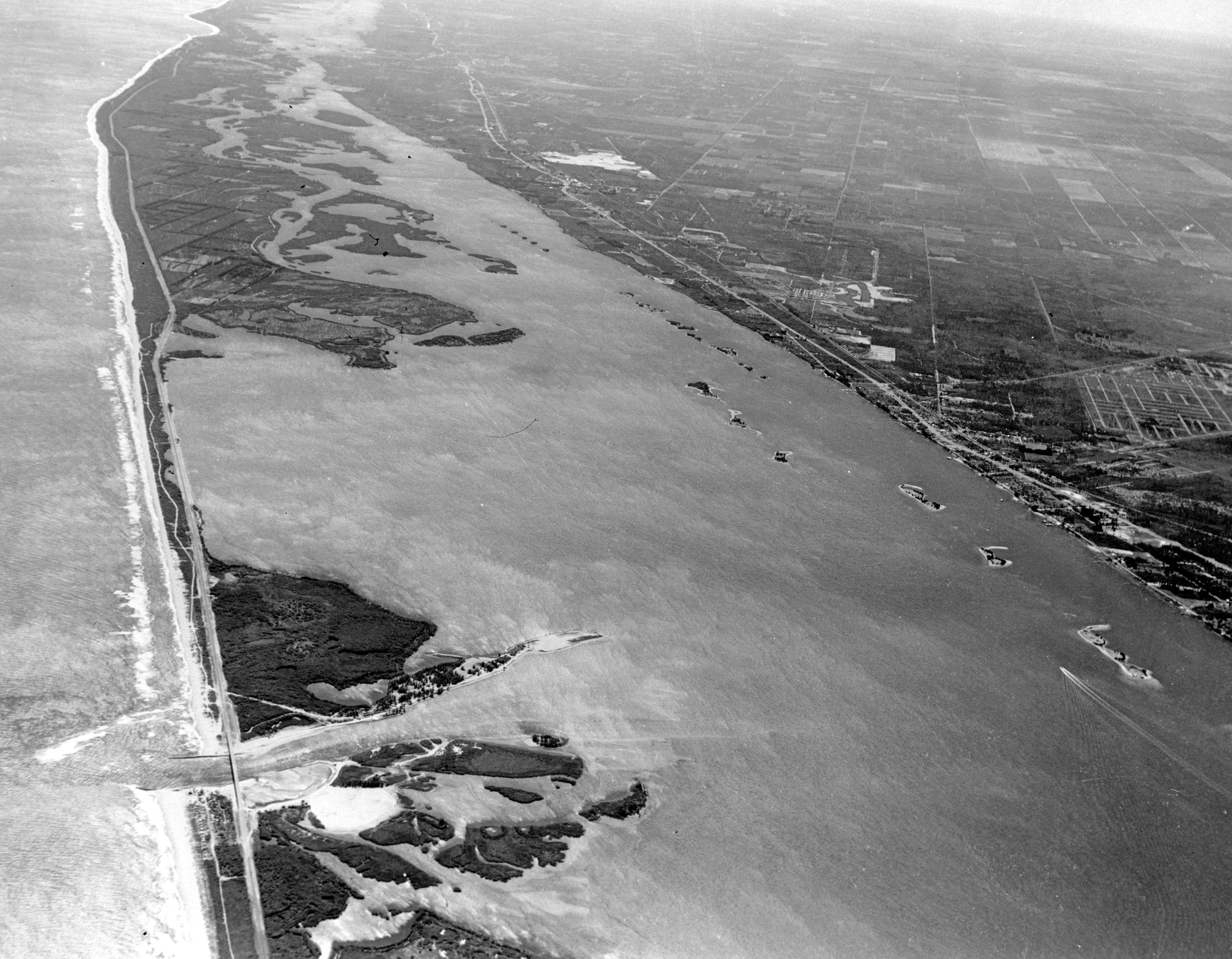 high altitude aerial view of the Sebastian Inlet from 1966 looking South over the lagoon and coastline