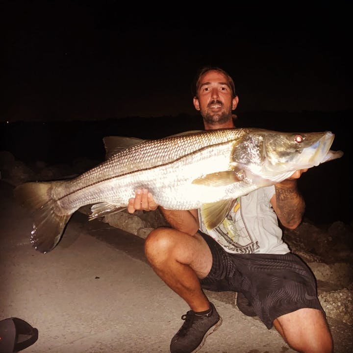 man holding giant fish