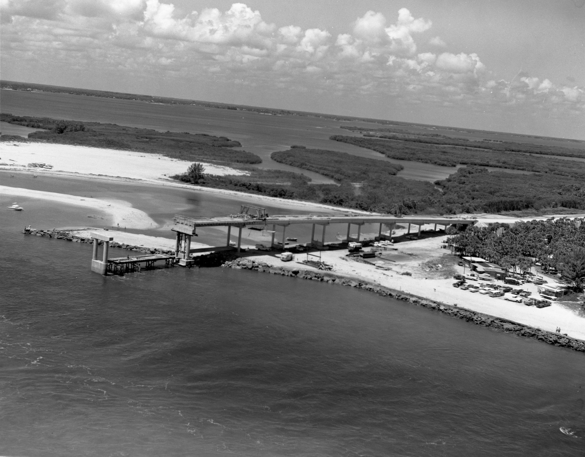 aerial view of construction of concrete support structures for bridge over Sebastian Inlet