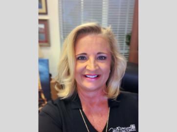 Tanya Quickel, woman, wearing black shirt