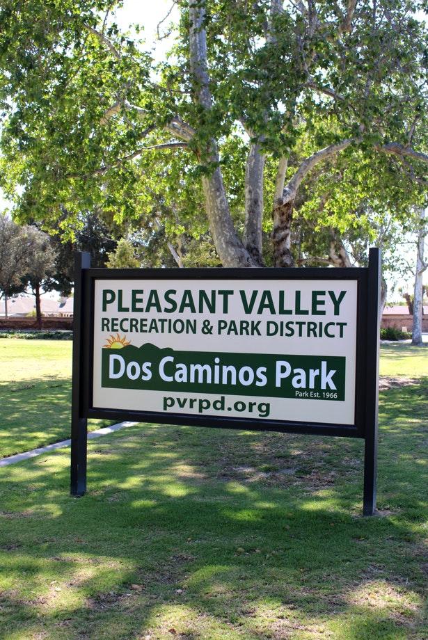 Dos Caminos Park sign