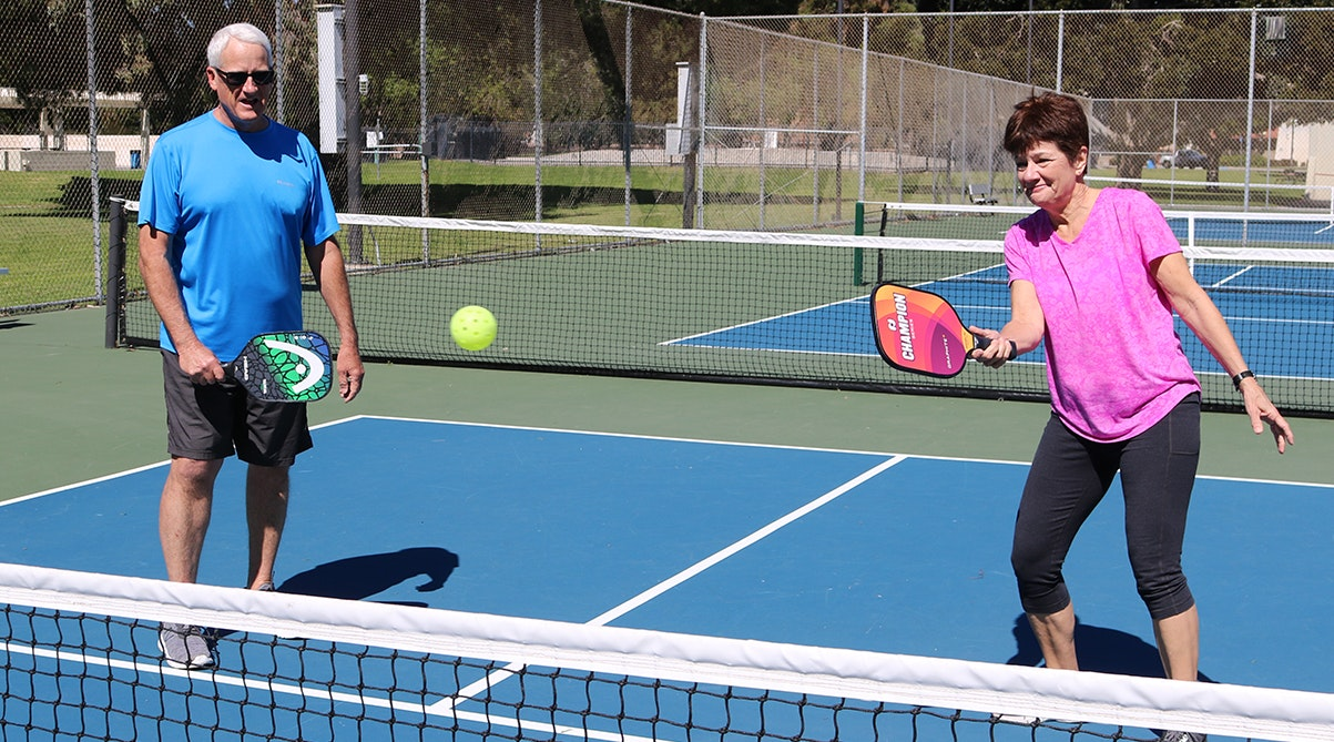 Couple playing Pickleball at Bob Kildee Park courts