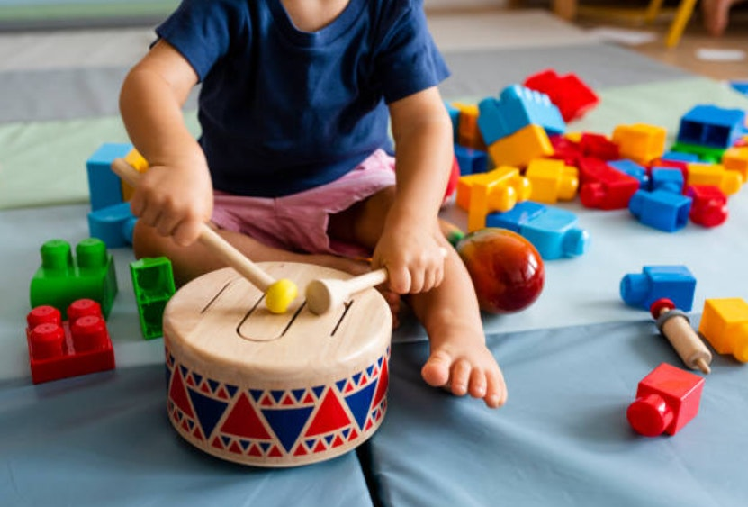 Tot playing drum