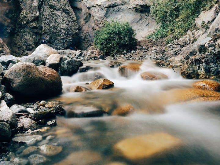River running downhill over rocks
