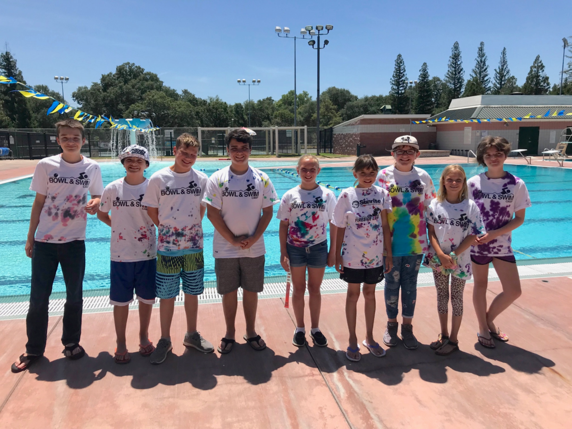 Bowl and Swim Campers in their shirts at the Rusch Pool