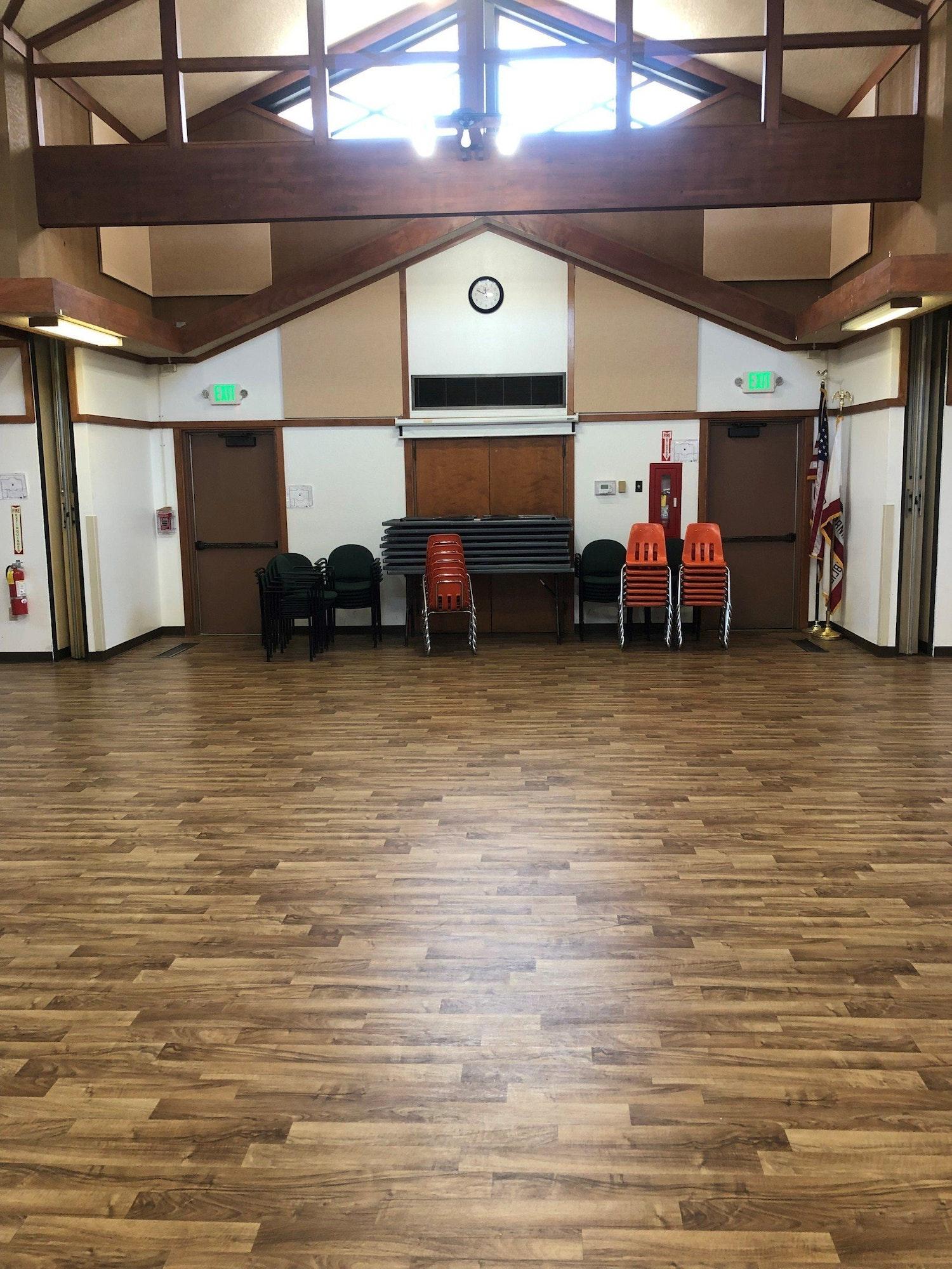 May contain: flooring, floor, furniture, chair, wood, hardwood, room, indoors, and rug