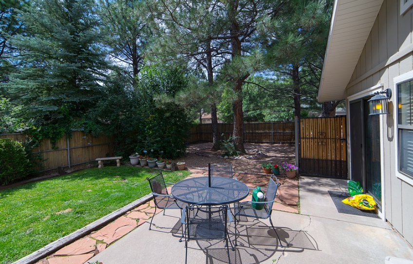 raised patio with metal furniture