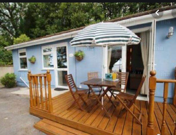 Wooden deck detached from house