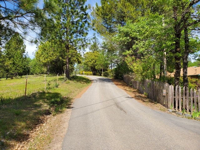 Road w/space on left, fence on right