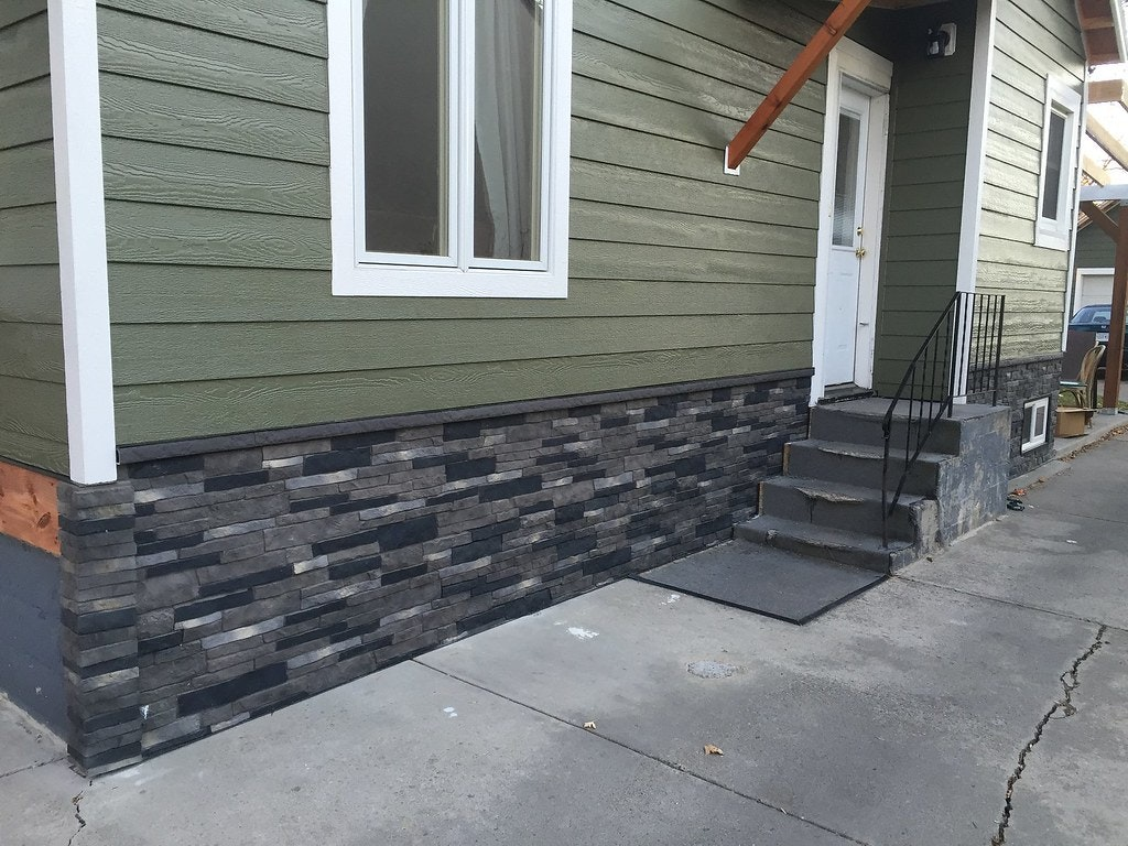 Stone siding at base of wall