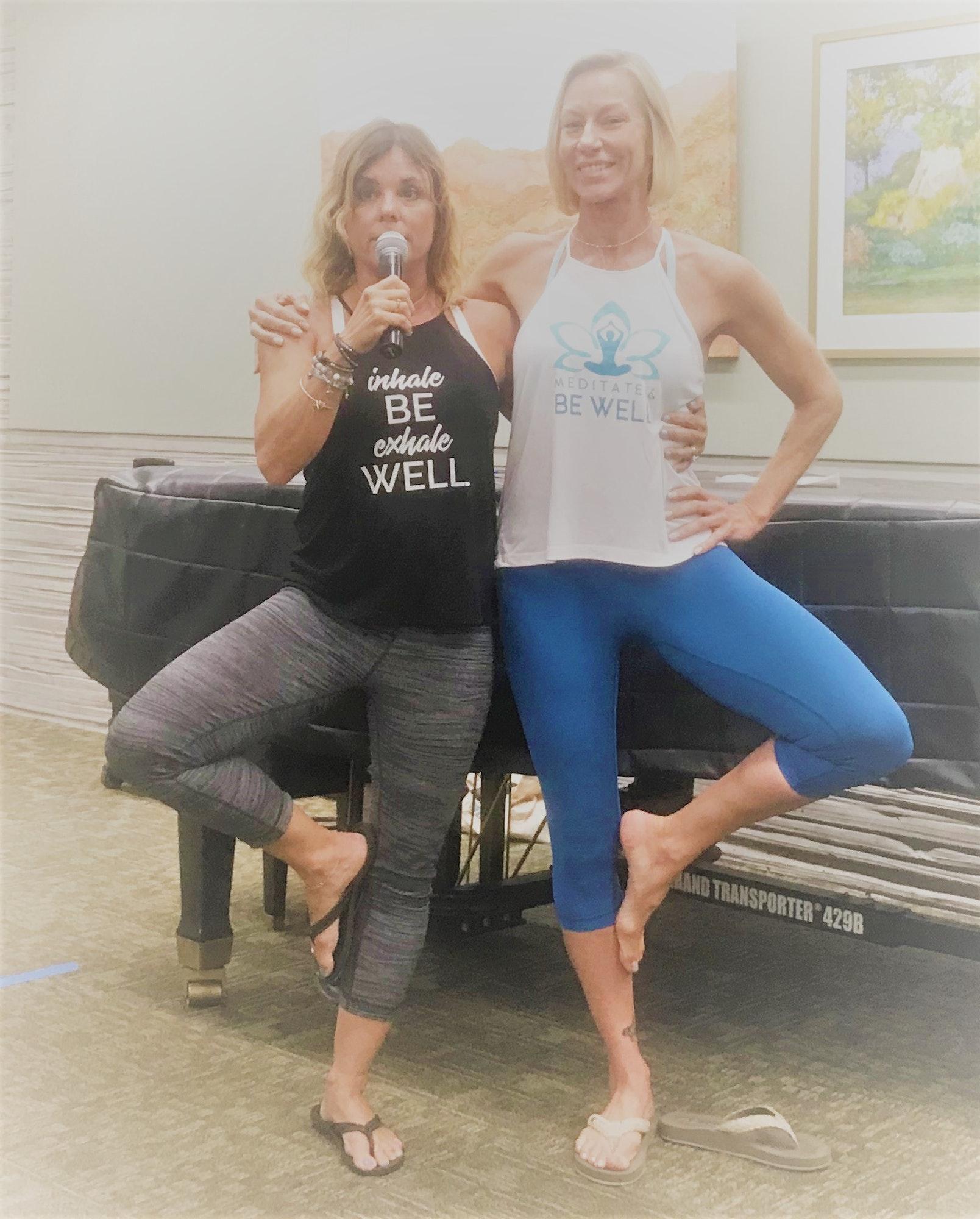 Mary and Heidi demonstrating a yoga pose