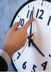 May contain: analog clock, clock, human, and person