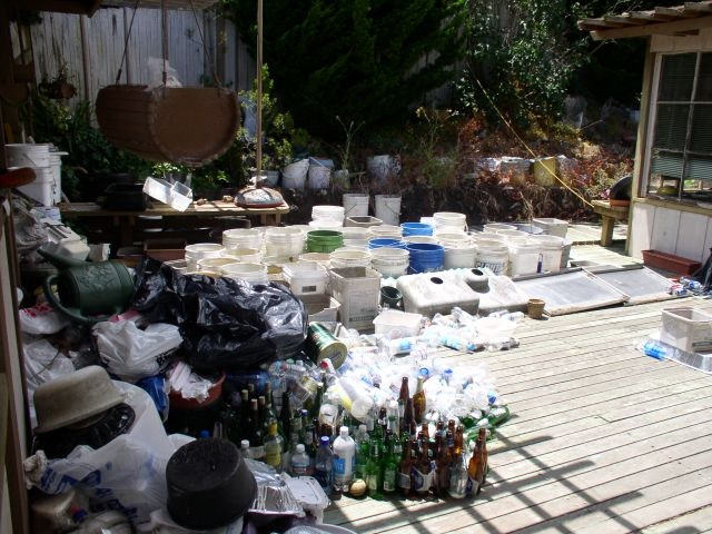 Backyard filled with containers holding water