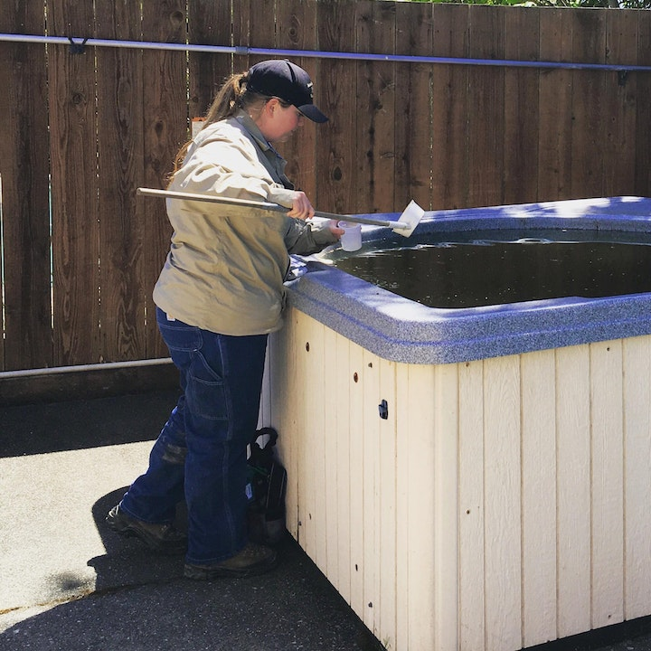 Vector control technician checking hot tub
