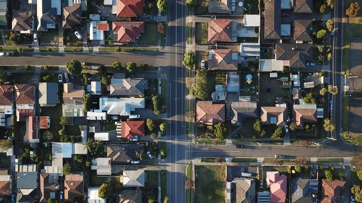 May contain: building, urban, neighborhood, outdoors, nature, landscape, scenery, road, suburb, and aerial view